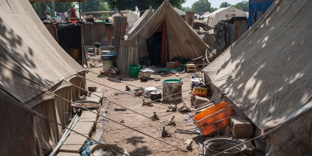 A picture taken on December 8, 2016 shows tents at the Internally Displaced People (IDP) camp, in Bama.The houses are burnt-out shells, and charred cars and petrol pumps line the roads in the once-bustling Nigerian trade hub of Bama before it was razed by Boko Haram jihadists, know 85% is destroyed. The camp now houses a little over 10,000 people who either escaped or survived the seven months under Boko Haram rule. The conflict with Boko Haram in northeast Nigeria has displaced more than 2.6 mi