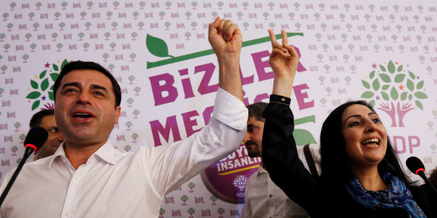 File Photo: Co-chairs of the pro-Kurdish Peoples' Democratic Party (HDP), Selahattin Demirtas and Figen Yuksekdag celebrate election results during a news conference in Istanbul, Turkey, June 7, 2015. REUTERS/Murad Sezer/File Photo