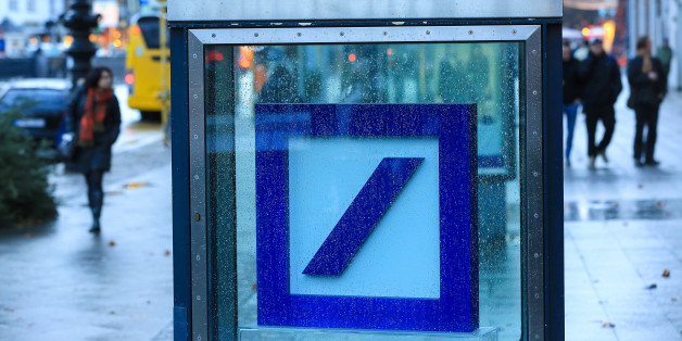 A Deutsche Bank AG logo sits inside a glass display case outside a bank branch in Berlin, Germany, on Wednesday, Jan. 4, 2017. Germany had another year of firm growth in 2016 and should continue to be propelled in 2017 by consumer spending. Photographer: Krisztian Bocsi/Bloomberg via Getty Images
