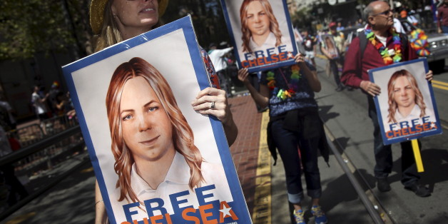 People hold signs calling for the release of imprisoned wikileaks whistleblower Chelsea Manning while marching in a gay pride parade in San Francisco, California June 28, 2015. Manning has appealed to an Army court to overturn her court-martial conviction, a court filing released on Thursday said.  REUTERS/Elijah Nouvelage/File Photo