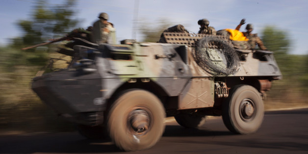 French troops ride on an amoured vehicle on a road near the frontline in their conflict with Islamists just outside Niono, January 19, 2013. France called on Saturday on other world powers to commit money and logistical support for African armies readying their troops to join French soldiers already battling al Qaeda-linked militants in Mali. REUTERS/Joe Penney (MALI - Tags: CIVIL UNREST MILITARY CONFLICT)