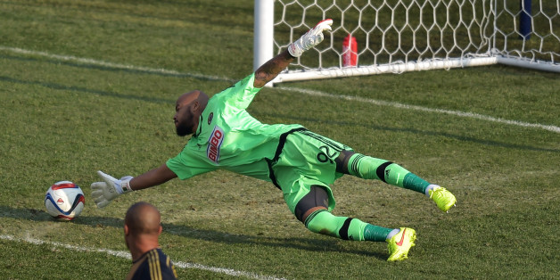 CHESTER, PA - MARCH 21: Fabinho #33 watches as teammate Rais Mbolhi #92 of Philadelphia Union is unable to make a save on the second goal of the second half during the game against FC Dallas at PPL Park on March 21, 2015 in Chester, Pennsylvania. Dallas won 2-0. (Photo by Drew Hallowell/Getty Images)