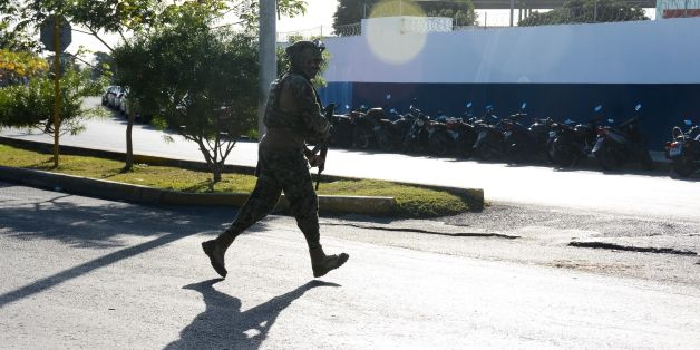 A marine arrives at the place where a shooting erupted after an attack against the building of the Quintana Roo State Prosecution, in Cancun, Mexico, on January 17, 2017. The shooting happened as Mexican authorities investigate whether a feud over local drug sales was behind a nightclub shooting that killed three foreigners and two Mexicans at a popular beach resort. Monday's shooting at the Blue Parrot club during the BPM electronic music festival rocked Playa del Carmen, a usually peaceful Caribbean seaside town. / AFP / STR        (Photo credit should read STR/AFP/Getty Images)