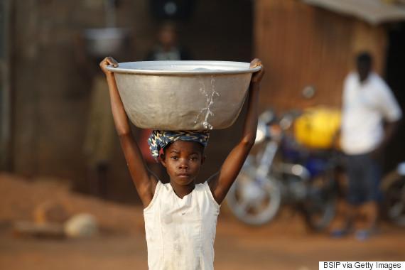 girl balancing water head