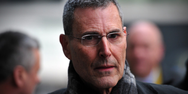 Israeli entertainer Uri Geller arrives to attend a hearing in civil cases taken against Rupert Murdoch's News Group Newspapers over phone hacking at the High Court in central London on February 8, 2013. Geller, was one of 17 people who settled their claims at London's High Court on February 8 brought against Rupert Murdoch's News Group Newspapers, publishers of the now-defunct News of the World tabloid newspaper, over phone hacking. Revelations that the News of the World had hacked celebrities led Murdoch to shut down the tabloid in July 2011. AFP PHOTO / CARL COURT        (Photo credit should read CARL COURT/AFP/Getty Images)
