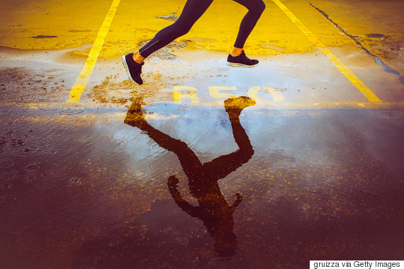 woman jogging street