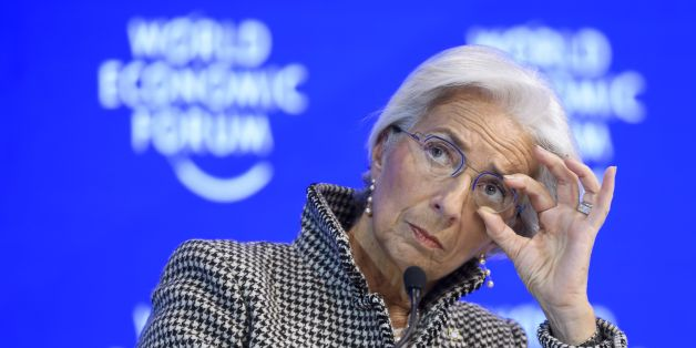 International Monetary Fund (IMF) managing director Christine Lagarde adjusts her glasses as she attends a session on the second day of the World Economic Forum, on January 18, 2017 in Davos.With the world's elite holding its breath until Donald Trump becomes the next US president, outgoing Vice-President Joe Biden addresses the World Economic Forum in Davos / AFP / FABRICE COFFRINI        (Photo credit should read FABRICE COFFRINI/AFP/Getty Images)