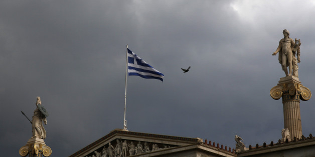 A Greek national flag flutters atop the university building as dark clouds fill the sky in Athens, Greece, June 30, 2015. Greece's conservative opposition warned on Tuesday that Sunday's vote over international bailout terms would be a referendum over the country's future in Europe, and that wages and pensions would be threatened if people were to reject the package.   REUTERS/Yannis Behrakis
