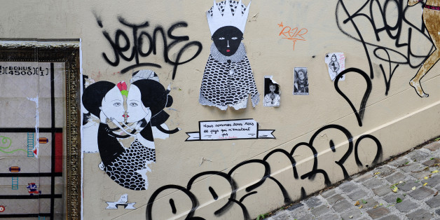 detail of graffiti painted illegally on public wall in Montmartre,Paris,France,Europe