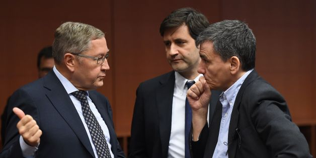 (L-R) Managing Director of the European Stability Mechanism Klaus Regling, Greek Alternate Minister of Finance George Chouliarakis and Greece's Finance Minister Euclid Tsakalotos speak during an Eurogroup finance ministers' meeting at the European Council in Brussels, January 14, 2016.  / AFP / EMMANUEL DUNAND        (Photo credit should read EMMANUEL DUNAND/AFP/Getty Images)