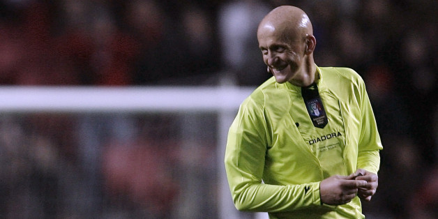 "Former FIFA soccer referee Pierluigi Collina of Italy smiles during the seventh ""Match against Poverty"" at Luz stadium in Lisbon January  25, 2010. With tickets at 10 euros each, the match will raise funds for victims of a manitude-7 quake on January 12 in Haiti which killed more than 200,000 people, leaving up to three million hurt or homeless in nightmarish conditions in the Western Hemisphere's poorest country.  REUTERS/Nacho Doce (PORTUGAL - Tags: SPORT SOCCER)"