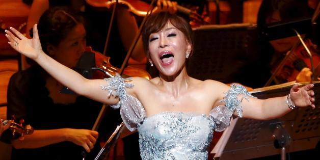 South Korean soprano singer Sumi Jo performs during the gala concert of the 50th anniversary of Japan and South Korea's resumption of normal ties after World War II at Suntory Hall in Tokyo June 22, 2015. East Asian neighbours South Korea and Japan marked the 50th anniversary of diplomatic ties on Monday with a push to mend relations strained for years by feuds over the legacy of Japan's wartime past.  REUTERS/Shizuo Kambayashi/Pool