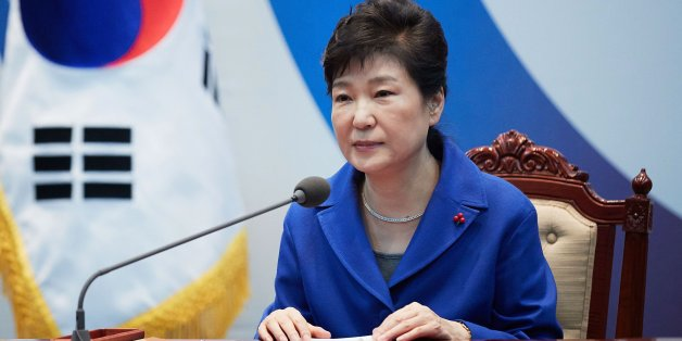 SEOUL, SOUTH KOREA - DECEMBER 09:  In this handout photo released by the South Korean Presidential Blue House, South Korea's President Park Geun-Hye attends the emergency cabinet meeting at the presidential office on December 9, 2016 in Seoul, South Korea. The South Korean National Assembly voted for an impeachment motion at its plenary session, which will set up the rare impeachment trial for President Park over the accusation of corruption involving Park and her long time confidante.  (Photo b