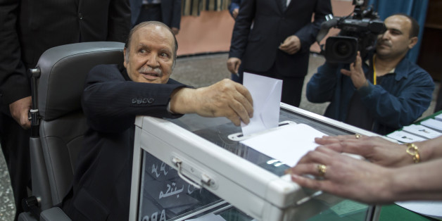 Algeria's President Abdelaziz Bouteflika casts his ballot during the presidential election in Algiers April 17, 2014. Algerians voted on Thursday in the election Bouteflika is expected to win after 15 years in power, despite speaking only rarely in public since suffering a stroke in 2013. REUTERS/Zohra Bensemra (ALGERIA - Tags: POLITICS ELECTIONS TPX IMAGES OF THE DAY)
