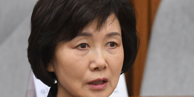 SEOUL, SOUTH KOREA - DECEMBER 15:  Choi Kyung-Hee, former president of Ewha Womans University, answers questions during a parliamentary hearing over the Choi Soon-sil gate probe at the National Assembly on December 15, 2016 in Seoul, South Korea. South Korea started the fourth round of a parliament hearing on the corruption scandal involving impeached President Park Geun-Hye.  (Photo by Kim Min-Hee-Pool/Getty Images)