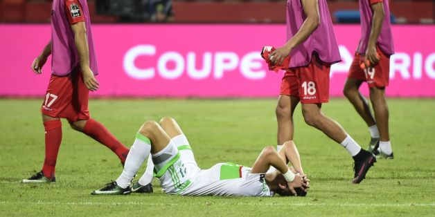Algeria's defender Rami Bensebaini reacts at the end of the 2017 Africa Cup of Nations group B football match between Algeria and Tunisia in Franceville on January 19, 2017. / AFP / KHALED DESOUKI        (Photo credit should read KHALED DESOUKI/AFP/Getty Images)