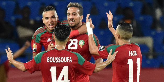 Morocco's midfielder Rachid Alioui (C) celebrates with teammates after scoring a goal during the 2017 Africa Cup of Nations group C football match between Morocco and Ivory Coast in Oyem on January 24, 2017. / AFP / ISSOUF SANOGO        (Photo credit should read ISSOUF SANOGO/AFP/Getty Images)
