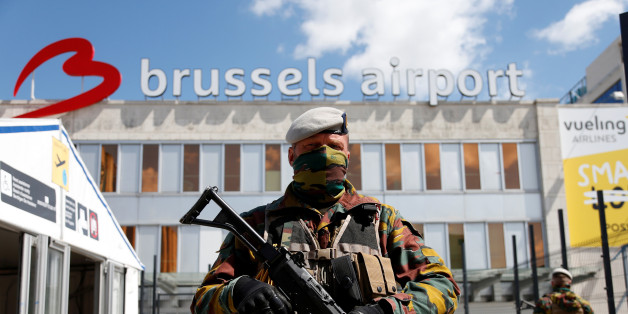 A Belgian soldier stands guard outside the partially reopened departure hall of Zaventem international airport near Brussels, Belgium, May 3, 2016. REUTERS/Francois Lenoir