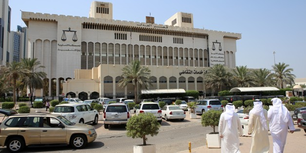 Kuwaitis arrive at the Palace of Justice where the sentence hearing of 29 defendants for their roles in a deadly Shiite mosque bombing claimed by the Islamic State group, takes place on September 15, 2015 in Kuwait City. A Kuwaiti court sentenced seven people to death, five of them in absentia, on charges of helping a Saudi suicide bomber carry out the June 26 attack, which killed 26 Shiite worshippers and wounded 227. AFP PHOTO / YASSER AL-ZAYYAT        (Photo credit should read YASSER AL-ZAYYA