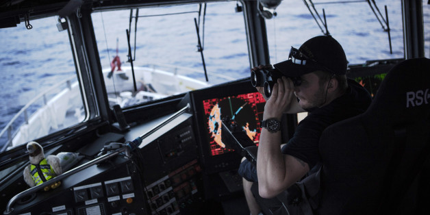 AT SEA - FEBRUARY 29:  Norwegian Redningsselskapet rescue boat 'Peter Henry Von Koss' conducts a Frontex sea patrol on the northern shores of Lesbos island on February 29, 2016. Crew officer Andras Johansen (L)  on the watch with binoculars for eventual refugee boats. Refugee boats would be monitored until they reach the Greek coast but no ID control is made at sea. Lesbos, the Greek vacation island in the Aegean Sea between Turkey and Greece, faces massive refugee flows from the Middle East countries. (Photo by Etienne De Malglaive/Getty Images)