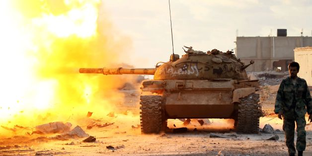 Members of the Libyan National Army (LNA) fire a tank during fighting against jihadists in Qanfudah, on the southern outskirts of Benghazi, on January 14, 2017.Khalifa Haftar's forces, which call themselves the Libyan National Army (LNA), have battled jihadists in second city Benghazi for more than two years and control key eastern oil export terminals. / AFP / Abdullah DOMA        (Photo credit should read ABDULLAH DOMA/AFP/Getty Images)