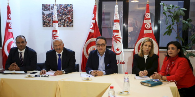 Hafhed Caid Essebsi (C), son of Tunisian president Beji Caid Essebsi, meets with Nidaa Tounes party leaders in Tunis, Tunisia November 3, 2015. Tensions between two wings of Nidaa Tounes, whose name means Call of Tunis, spilled over into violence last week when a party meeting descended into open fighting with fists and sticks. A split within Nidaa Tounes could trigger political instability in the country that launched the first of the Arab Spring revolutions in 2011. Thirty-two of Nidaa Tounes' 86 lawmakers have already threatened to break away in protest at what they see as attempts by President Beji Caid Essebsi, who founded the secular party in 2012, to impose his son Hafhed as its leader. The president's office rejects those accusations.  REUTERS/Zoubeir Souissi
