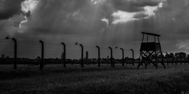 Auschwitz, Poland - May 26, 2014: The Auschwitz concentration camp is located about 50 km from Krakow. The picture shows fiew guard towers in camp.