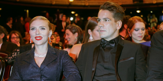 U.S. actress Scarlett Johansson and her partner Romain Dauriac attend the 39th Cesar Awards ceremony in Paris February 28, 2014.  REUTERS/Jacky Naegelen (FRANCE  - Tags: ENTERTAINMENT)