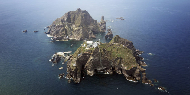 A set of remote islands called Dokdo in Korean and Takeshima in Japanese is seen in this picture taken from a helicopter carrying South Korean President Lee Myung-bak (not pictured), east of Seoul August 10, 2012. Lee visited the islands on Friday, angering neighbour Japan which also lays claims to territory. South Korea controls the islands with a coast guard presence and plans to beef up maritime research.   REUTERS/The Blue House/Handout   (POLITICS)   FOR EDITORIAL USE ONLY. NOT FOR SALE FOR
