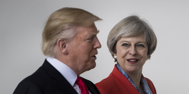 US President Donald Trump and British Prime Minister Theresa May walk at the White House on January 27, 2017 in Washington, DC. / AFP / Brendan Smialowski        (Photo credit should read BRENDAN SMIALOWSKI/AFP/Getty Images)