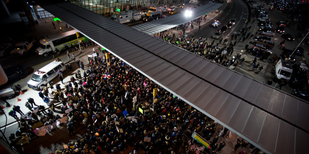 Demonstrators gather outside John F. Kennedy International Airport (JFK) to protest U.S. President Donald Trump's executive order blocking visitors from seven predominantly Muslim nations in New York, U.S., on Saturday, Jan. 28, 2017. A U.S judge temporarily blocked the Trump administration from enforcing an executive order that would have led to the deportation of refugees and visa-holders from seven mostly Muslim countries. Photographer: Michael Nagle/Bloomberg via Getty Images