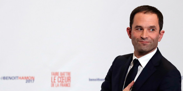 Former French education minister Benoit Hamon reacts after partial results in the second round of the French left's presidential primary election in Paris, France, January 29, 2017.    REUTERS/Christian Hartmann