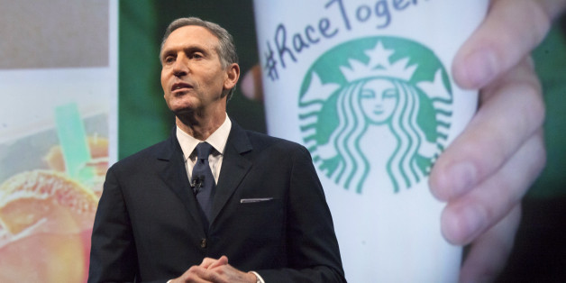 """Starbucks Corp Chief Executive Howard Schultz, pictured with images from the company's new """"Race Together"""" project behind him, speaks during the company's annual shareholder's meeting in Seattle, Washington March 18, 2015. Schultz has deftly navigated thorny issues such as gay marriage, gun control and Congressional gridlock, but his move to weigh in on U.S. race relations has brewed up a social media backlash. The company kicked off the discussion when it published full-page ads in major U.S. n"""
