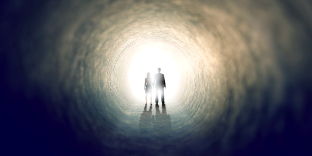 A shot of two people finding an exit from a dark tunnel - ALL design on this image is created from scratch by Yuri Arcurs'  team of professionals for this particular photo shoot