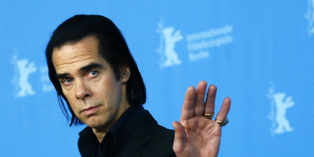 "Cast member Nick Cave poses during a photocall promoting the movie ""20,000 Days on Earth"" at the 64th Berlinale International Film Festival in Berlin February 10, 2014. REUTERS/Thomas Peter (GERMANY - Tags: ENTERTAINMENT)"