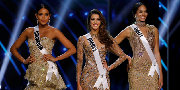 Miss France Iris Mittenaere (C) and other finalists Miss Haiti Jacque Pellisier (R) and Miss Colombia Andrea Tovar pose shortly before Mittenaere wins the 65th Miss Universe beauty pageant at the Mall of Asia Arena, in Pasay, Metro Manila, Philippines January 30, 2017. REUTERS/Erik De Castro