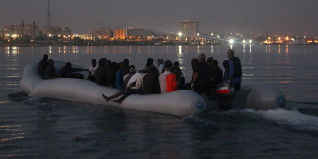 Illegal migrants are seen on a boat that they used, after being detained at a Libyan Navy base in the coastal city of Tripoli September 20, 2015. REUTERS/Hani Amara