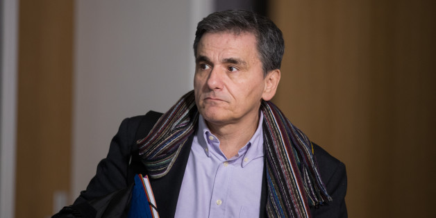 Euclid Tsakalotos, Greece's finance minister, departs from a Eurogroup meeting of euro-area finance ministers at the Europa building in Brussels, Belgium, on Thursday, Jan. 26, 2017. Greece has less than a month to iron out disagreements with its creditors over how to move forward with a rescue package that has been keeping the country afloat since 2010. Photographer: Jasper Juinen/Bloomberg via Getty Images