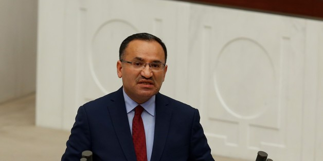 ANKARA, TURKEY - JANUARY 9: Turkey's Minister of Justice Bekir Bozdag makes a speech during the parliamentary session for the debates on a bill to change the Turkish constitution at the Turkish Grand National Assembly (TBMM) in Ankara, Turkey on January 9, 2017. Parliaments general assembly started debate over a landmark bill to change the countrys constitution. (Photo by Murat Kaynak/Anadolu Agency/Getty Images)