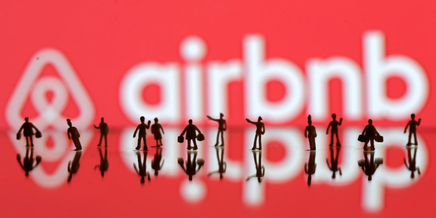 REFILE-CORRECTING GRAMMAR A 3D printed people's models are seen in front of a displayed Airbnb logo in this illustration taken, June 8, 2016. REUTERS/Dado Ruvic/Illustration TPX IMAGES OF THE DAY