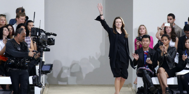 British-born designer Clare Waight Keller appears on the runway after presenting her Spring/Summer 2014 women's ready-to-wear collection for French fashion house Chloe during Paris Fashion Week September 29, 2013. REUTERS/Benoit Tessier (FRANCE - Tags: FASHION)