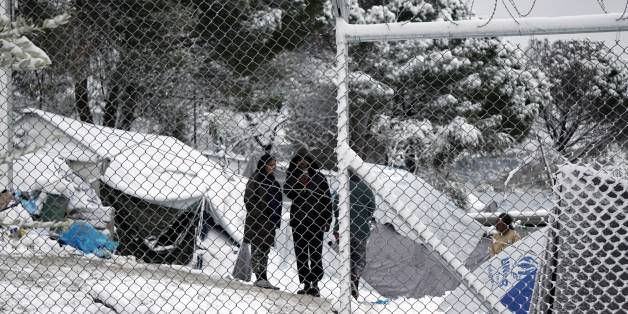 Migrants stand next to their tents at the Moria hotspot on the island of Lesbos , following heavy snowfalls on January 7, 2017. The number of migrants arriving in Europe by two main sea routes in 2016 plunged by almost two-thirds to 364,000 compared with the previous year, EU border agency Frontex said Friday. Frontex pointed to an EU border deal with Turkey which came into effect in March as having paved the way to a massive decline in the arrival of Syrian refugees and other migrants in Greece