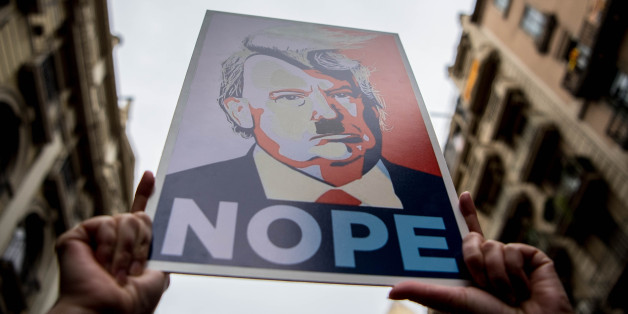 BARCELONA, SPAIN - JANUARY 21:  Demonstrators hold posters of Donald Trump as they make their way during the Women's March on January 21, 2017 in Barcelona, Spain. The Women's March originated in Washington DC but soon spread to be a global march calling on all concerned citizens to stand up for equality, diversity and inclusion and for women's rights to be recognised around the world as human rights. Global marches are now being held, on the same day, across seven continents.  (Photo by David Ramos/Getty Images)