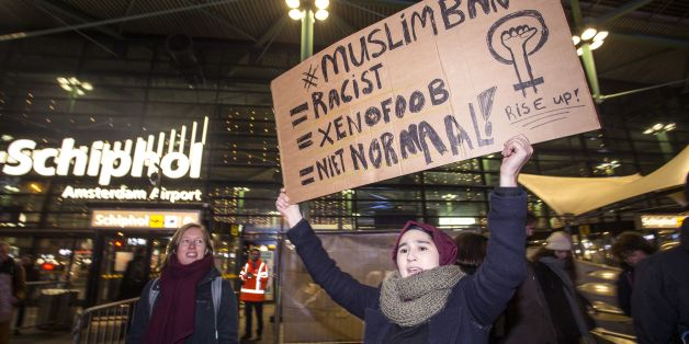 People gather to protest against US President Donald Trump's sweeping executive order, which restricts refugees and travellers from seven Muslim-majority countries, at Schiphol Airport, near Amsterdam, on January 29, 2017. / AFP / ANP / ALEXANDER SCHIPPERS / Netherlands OUT        (Photo credit should read ALEXANDER SCHIPPERS/AFP/Getty Images)