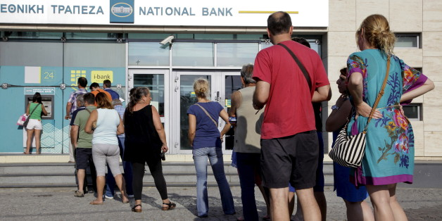 People line up to withdraw cash from an automated teller machine (ATM) outside a National Bank branch in Iraklio on the island of Crete, Greece June 28, 2015. Greece's Prime Minister Alexis Tsipras on Sunday announced a bank holiday and capital controls after Greeks responded to his surprise call for a referendum on bailout terms by pulling money out of banks.  REUTERS/Stefanos Rapanis