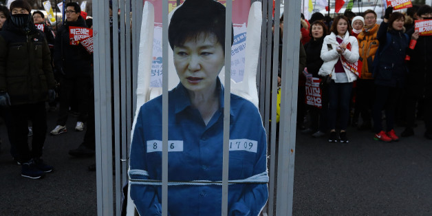 SEOUL, SOUTH KOREA - DECEMBER 10: Protesters gathered and occupy major streets in the city center for a rally against South Korean President Park Geun-Hye on December 10, 2016 in Seoul, South Korea. The South Korean National Assembly voted yesterday for an impeachment motion at its plenary session, which will set up the rare impeachment trial for President Park over the accusation of corruption involving Park and her long time confidante.  (Photo by Chung Sung-Jun/Getty Images)