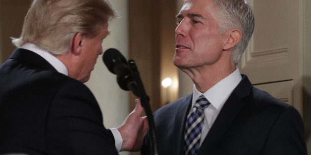WASHINGTON, DC - JANUARY 31: U.S. President Donald Trump pats on the shoulder of Judge Neil Gorsuch after he nominates him to the Supreme Court during a ceremony in the East Room of the White House January 31, 2017 in Washington, DC.Ê ÊIf confirmed, Gorsuch would fill the seat left vacant with the death of Associate Justice AntoninÊScaliaÊin February 2016.Ê  (Photo by Alex Wong/Getty Images)