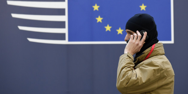 A member of security speaks on his mobile phone as European Union leaders arrive for a summit focused on Russia sanctions and migration at the European Council in Brussels on December 15, 2016. A EU summit was focusing on Russia sanctions and migration on December 15, with 27 leaders also meeting over dinner to discuss Brexit, without British Prime Minister Theresa May.  / AFP / JOHN THYS        (Photo credit should read JOHN THYS/AFP/Getty Images)