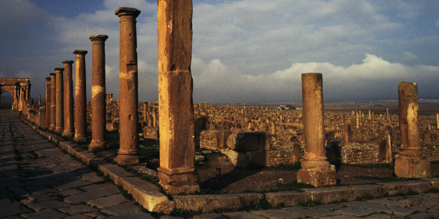 ALGERIA - MAY 12: View of colonnaded cardo, ruins of the Roman city of Timgad (formerly Thamugadi), founded in ca 100 AD by order of Trajan (Unesco World Heritage List, 1982), Algeria. (Photo by DeAgostini/Getty Images)