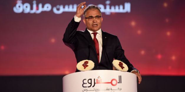 The General Secretary of Machrou3 Tounes Party Mohsen Marzouk gives a speech in Tunis on July 23, 2016 during the opening of the first congress of his new party that was formed following a split from the secular Nidaa Tounes party of the current Tunisian president.  / AFP / FETHI BELAID        (Photo credit should read FETHI BELAID/AFP/Getty Images)